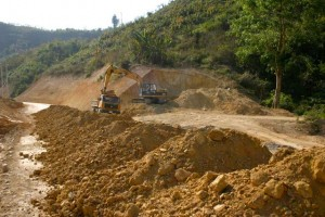 Project Phongsali 2011:  Road crews move soil about.  Villagers find bombs and other ordnance.