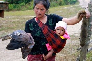 Project Sekong 2012: With children in tow, Lao women work hard and often set the pace.